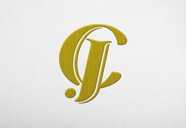 Aplikace monogramu JC na textil - výšivka
